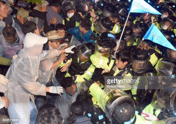Scuffling with riot police on Sept 6 in Seongju southeast of Seoul demonstrators protest the installation of four additional Terminal High Altitude...