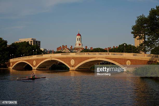 A sculler rows on the Charles River past the Harvard University campus in Cambridge Massachusetts US on Tuesday June 30 2015 Harvard University...