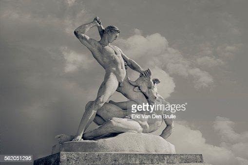 Sculpted figures of a man fighting a minotaur