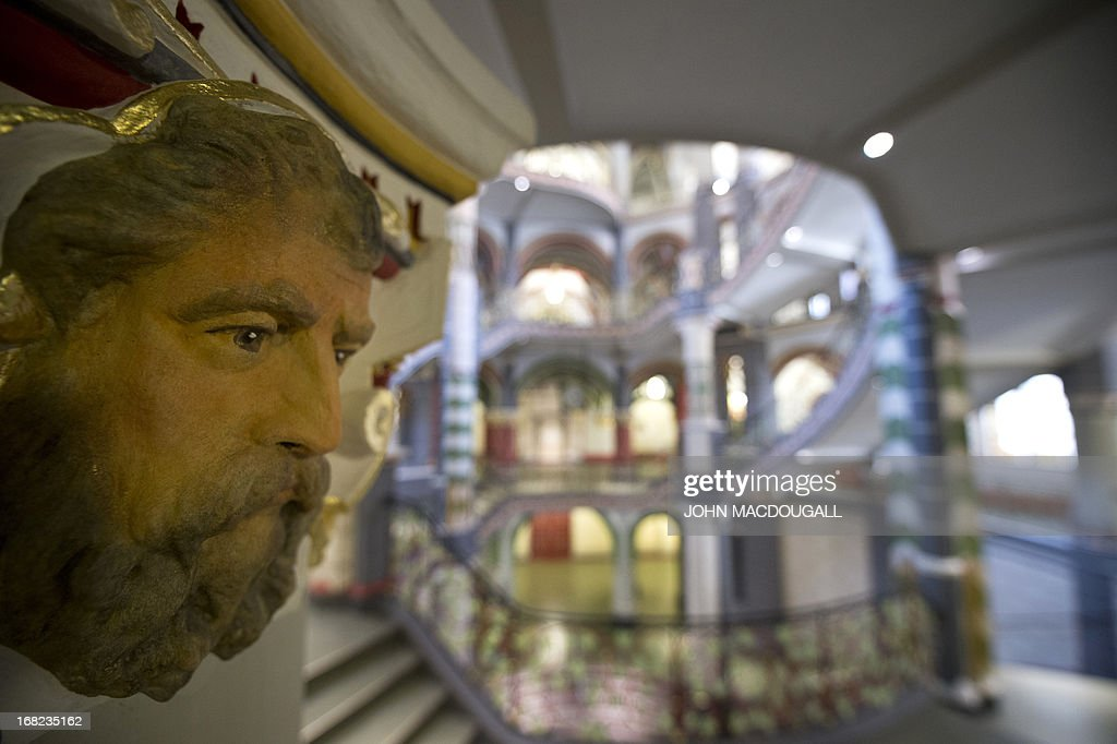 A sculpted head, can be seen in the capital of a column in the newly restored regional court house (Landgericht) in Halle, eastern Germany, on May 6, 2013. The neo-Baroque building, which combines Gothic, Renaissance and Art Nouveau styles, was completed in 1905. The building's 20 courtrooms, 110 offices were painstakingly renovated over a two-year period, and will officially reopen for business in May 2013.