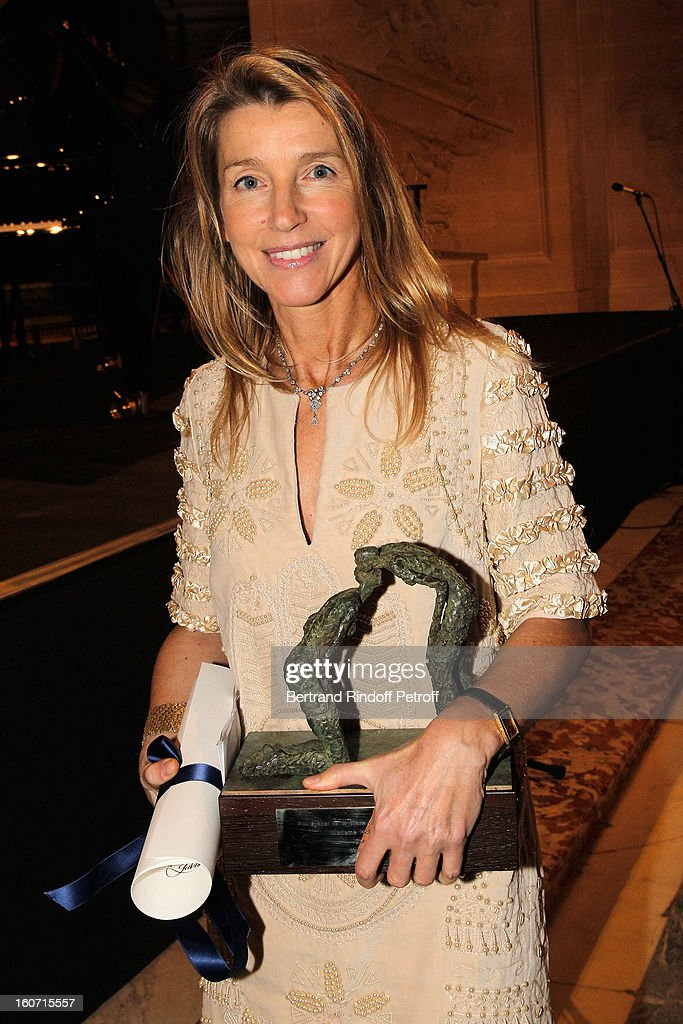 Sculptor Helene Jousse, who sculpted the award she holds, poses after shereceived the Special Prize of the Paris Charter against Cancer during the gala dinner of Professor David Khayat's association 'AVEC', at Chateau de Versailles on February 4, 2013 in Versailles, France.