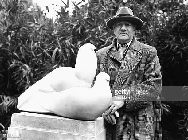 Sculptor Jacob Epstein with his sculpture 'The Doves' at an LCC open air exhibition in Holland Park London May 24th 1954
