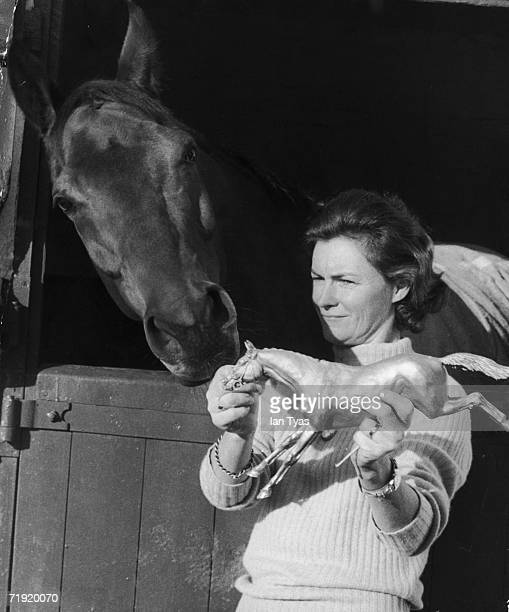 Sculptor Lady Yarrow checks her model for a one third lifesize bronze statue of champion racehorse Red Rum against the real thing 6th December 1974...