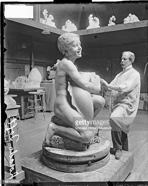 Sculptor Lorado Taft at work on the Fountain of the Great Lakes sculpture in his studio Chicago Illinois February 15 1913 From the Chicago Daily News...