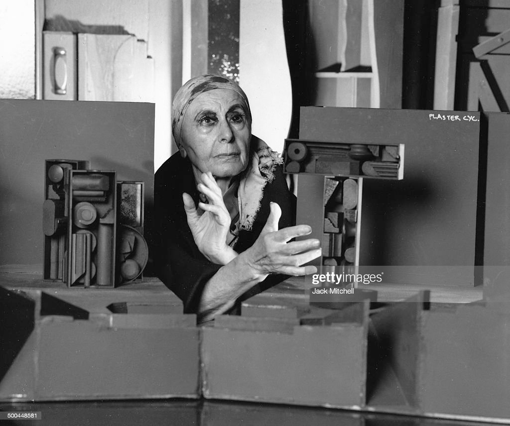 Sculptor Louise Nevelson photographed in her New York City studio in 1974
