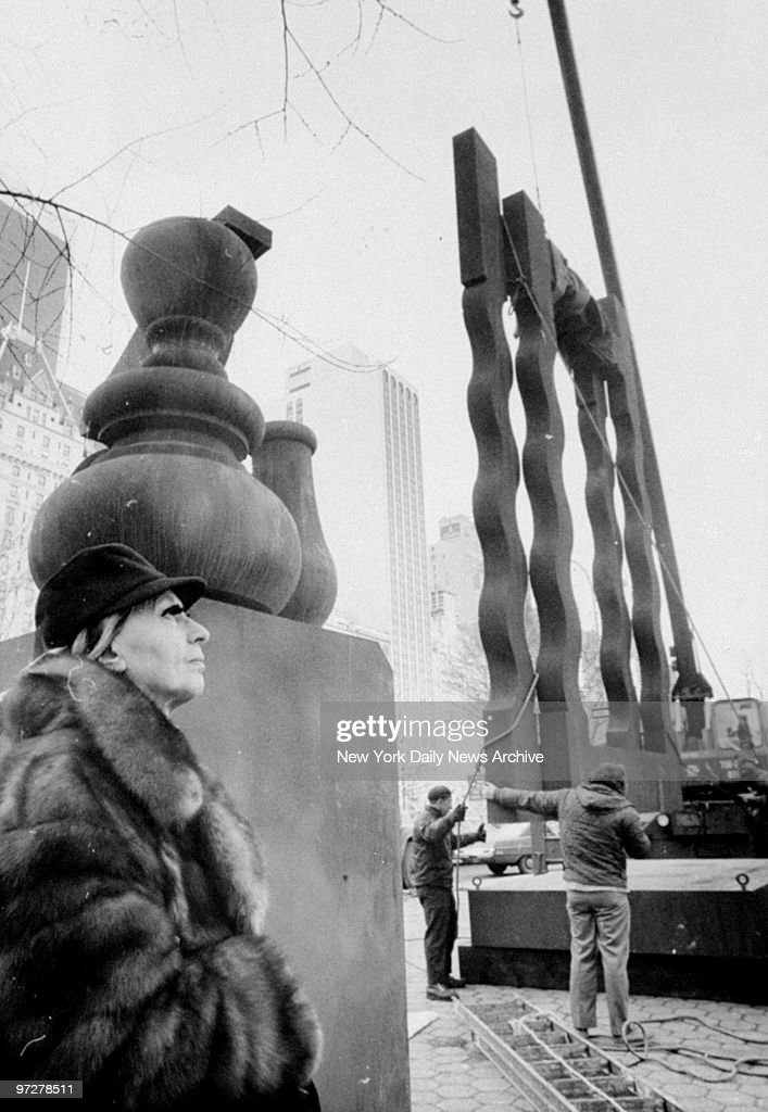Sculptor Louise Nevelson with her sculpture 'Night Presence IV' which is being installed at 60th St and Fifth Ave in Central Park