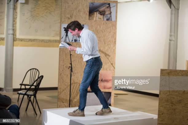 Sculptor Michael Dean reads 'Tombeau pour Cinq Cent Mille Soldats' for 50th anniversary of the book at Azzedine Alaia Gallery on October 19 2017 in...