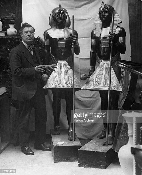 Sculptor Mr Aumonier with his models of the guardians of Tutankhamen's tomb at an exhibition at Wembley London