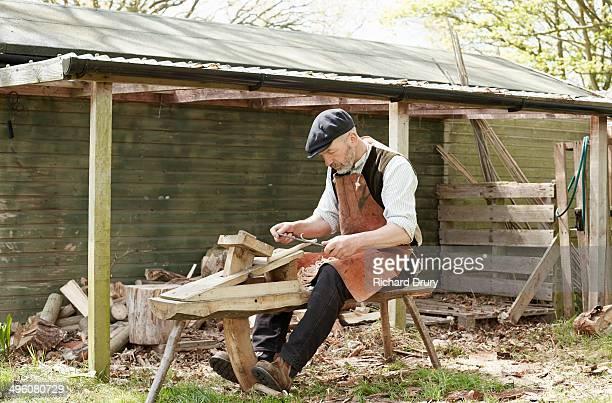 Sculptor using shaving horse