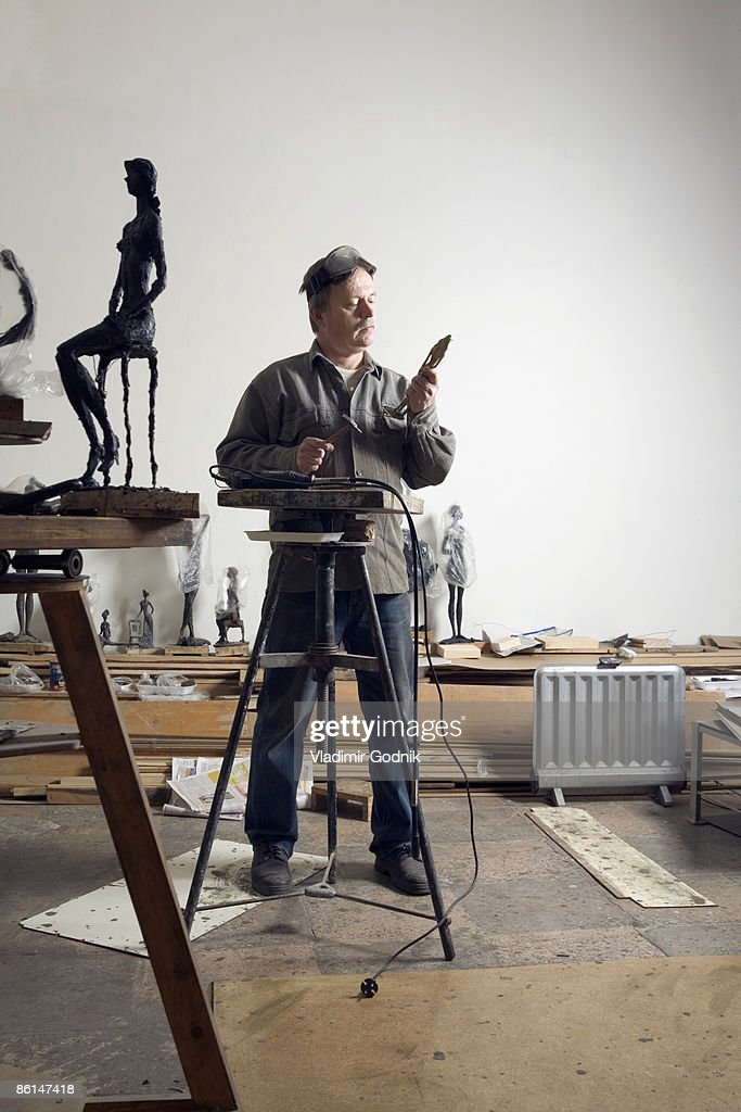 A sculptor working in an art studio