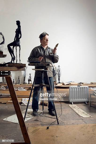 A sculptor working in an art studio