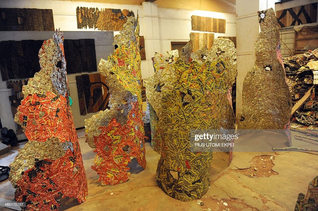 Sculptural works of Professor El Anatsui made with bottle caps at his Nsukka studio on August 8, 2013. The Ghanaian-born Anatsui's first big step toward international acclaim happened in 1990 when he and four others became the first artists from sub-Saharan Africa invited to exhibit at the Venice Biennale, one of the world's most prestigious showcases. His prominence has grown steadily since, including shows in the world's cultural capitals but 1999 is widely seen as a turning point.