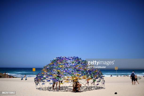 A sculpture by artist Jane Cowie is displayed during the 'Sculpture by the Sea' exhibition near Bondi beach in Sydney on October 19 2017 The...