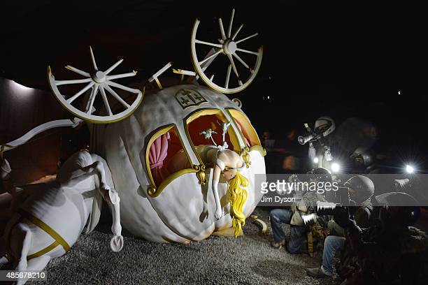 A sculpture by Banksy depicts Cinderella photographed by papparazi after being pursued in her wedding chariot as Banksy's Dismaland Bemusement Park...