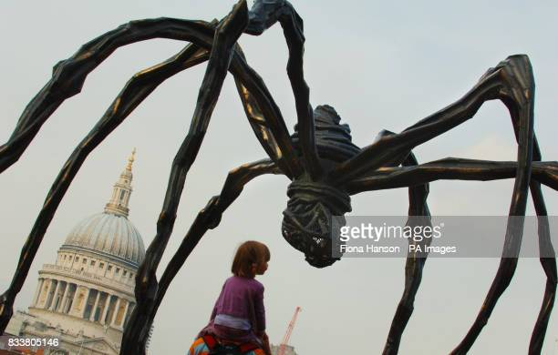 A sculpture by Frenchborn artist Louise Bourgeois of a giant spider Maman 1999 stands outside the Tate Modern gallery in London