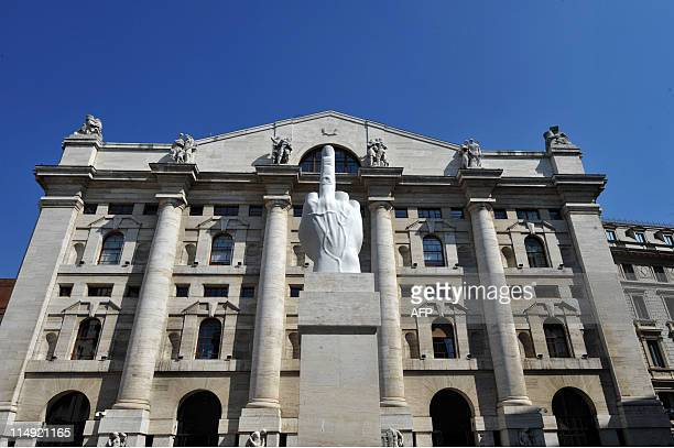 A sculpture by Italian artist Maurizio Cattelan is seen in front of the Milan stock exchange on May 23 2011 Italy has clocked the lowest growth rate...