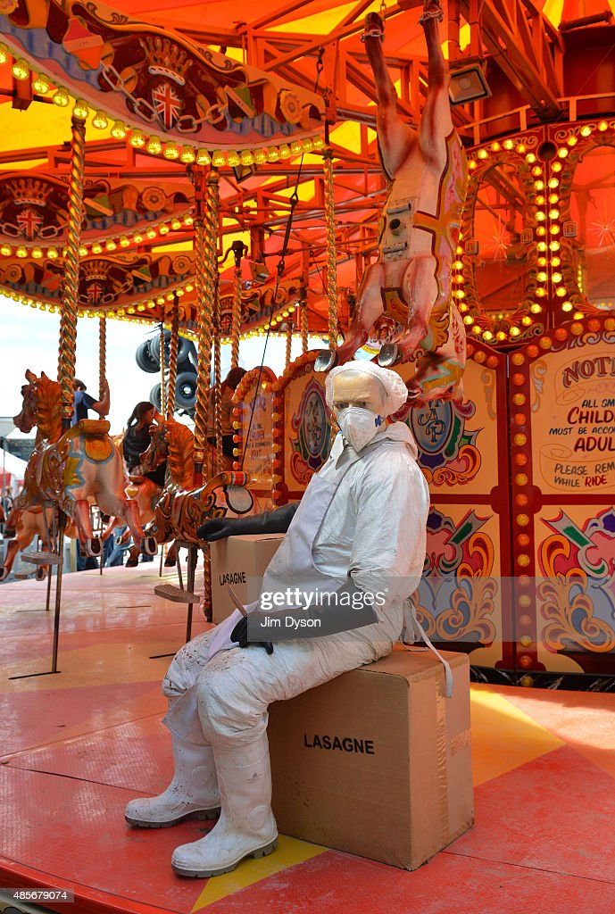 A sculpture depicts a 'horse meat' butcher on a carousel as Banksy's Dismaland Bemusement Park opens to the public on August 28 2015 in...