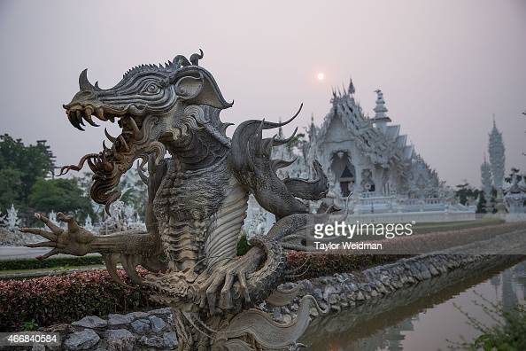 A sculpture emerges from a moat surrounding Wat Rong Khun on March 19 2015 in Chiang Rai Thailand After an incident last month Wat Rong Khun refused...