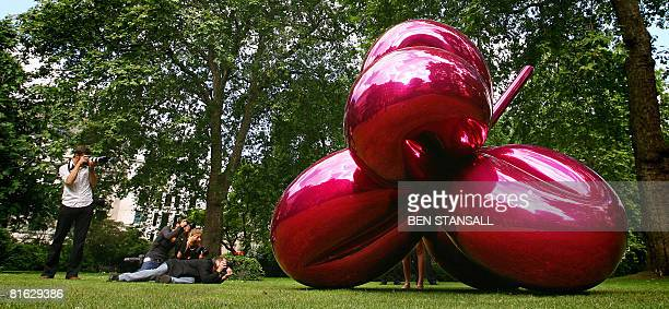 A sculpture entitled 'Balloon Flower ' by US artist Jeff Koons is pictured in St James Park in London on June 19 2008 The sculpture will be offered...