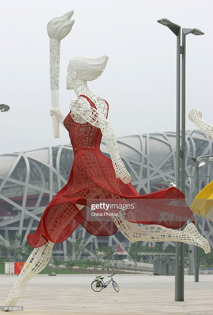 A sculpture is seen in front of the National Stadium at the Olympic Green area on July 4, 2008 in Beijing, China. Beijing's Olympic Green is the core of the Olympic Games and the site of thirteen venues, including the National Stadium and the National Aquatics Center.
