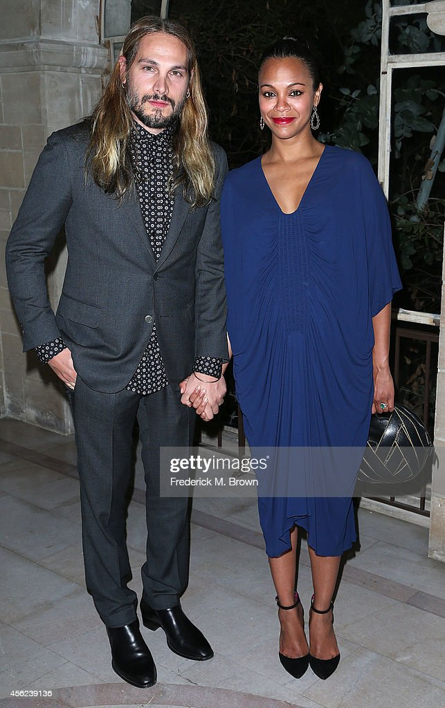 Sculpture Marco Perego (L) and actress Zoe Saldana attend LAXART's 1st Biannual Gala at Greystone Mansion on September 27, 2014 in Beverly Hills, California.