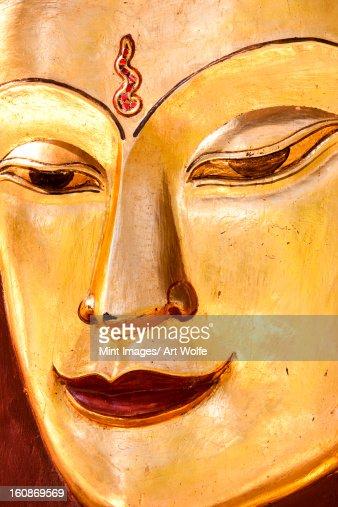 Sculpture of a Buddha. Close up of the face, Mandalay, Myanmar : Stock Photo