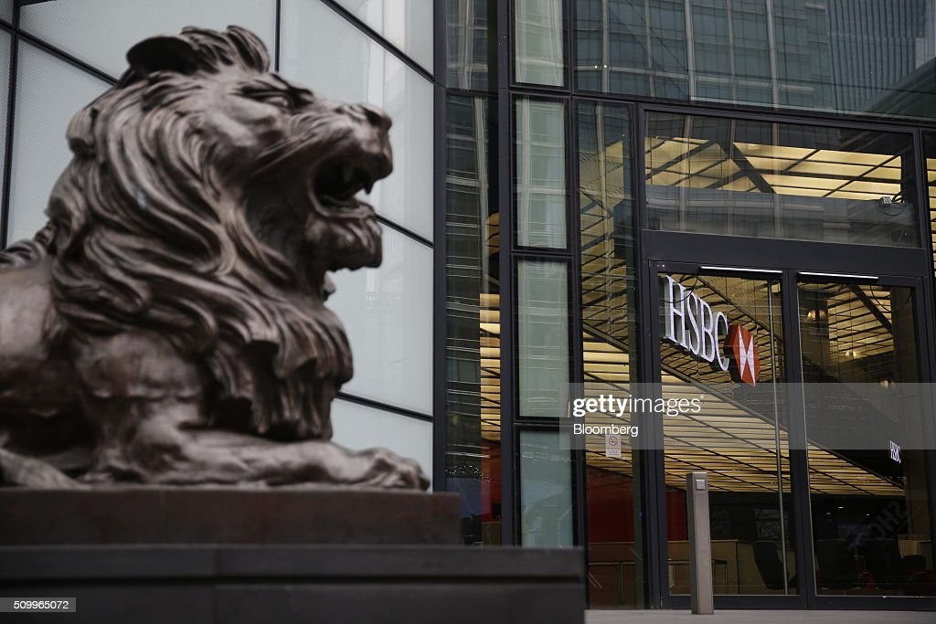 A sculpture of a lion sits outside the main entrance to the HSBC Holdings Plc headquarters in the Canary Wharf business, financial and shopping district in London, U.K., on Saturday, Feb. 13, 2016. HSBC's board will meet on Sunday to decide whether to shift its headquarters from London, according to two people with knowledge of the decision. Photographer: Luke MacGregor/Bloomberg via Getty Images