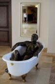 A sculpture of a man in a bath of oil is seen at the Chinar Hotel Spa on September 13 2012 in Naftalan near the city of Ganja Azerbaijan Naftalan oil...