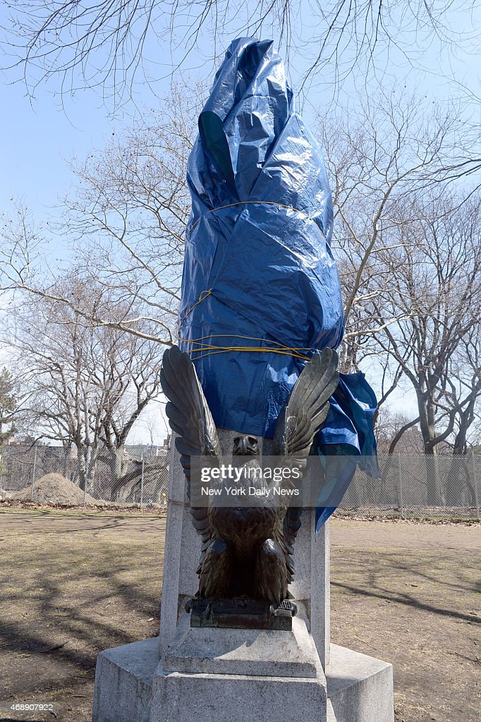 A sculpture of <a gi-track='captionPersonalityLinkClicked' href=/galleries/search?phrase=Edward+Snowden&family=editorial&specificpeople=10983676 ng-click='$event.stopPropagation()'>Edward Snowden</a> is taken down from atop a column in Brooklyn's Fort Greene Park. The NYC Parks Department covered it with a tarp before carrying it away on the back of a parks department truck. The column is part of the Prison Ship Martyrs Monument, a site built to honor more than 11,000 American prisoners of war who died aboard British ships during the American Revolutionary War.