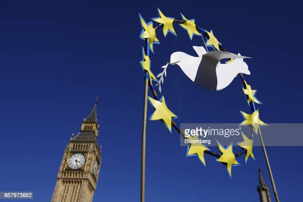 A sculpture of European Union stars and a peace dove stands in front of Elizabeth Tower commonly referred to as Big Ben during a Unite for Europe...