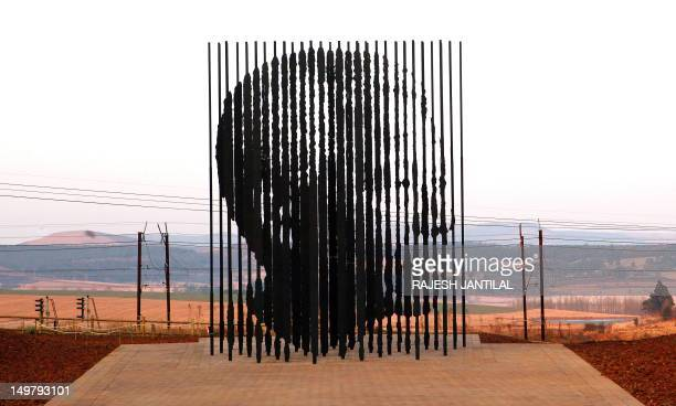 A sculpture of former South African President Nelson Mandela is presented on August 4 2012 in Howick 90 kms South of Durban commemorating the 50th...