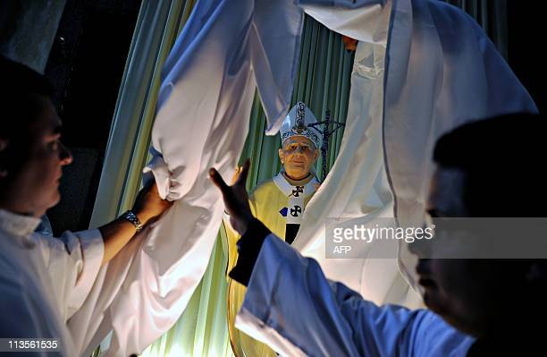 A sculpture of late Pope John Paul II is unveiled during a mass in his honour at the Metropolitan Cathedral in Managua on May 1 on the day of his...