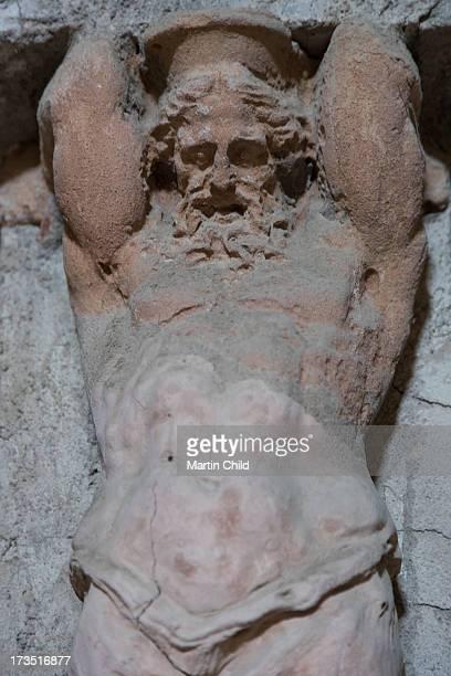 sculpture of man in the baths at Herculaneum