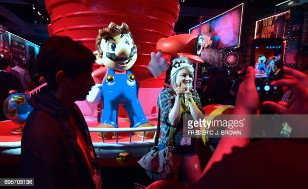 A sculpture of Nintendo icon Super Mario proves popular for selfies and photo ops at the Los Angeles Convention center on day one of E3 2017 the...