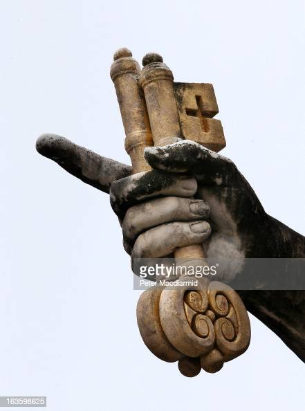 A sculpture of St Peter holding the key to heaven stands in St Peter's Square on March 13 2013 in Vatican City Vatican Pope Benedict XVI's successor...