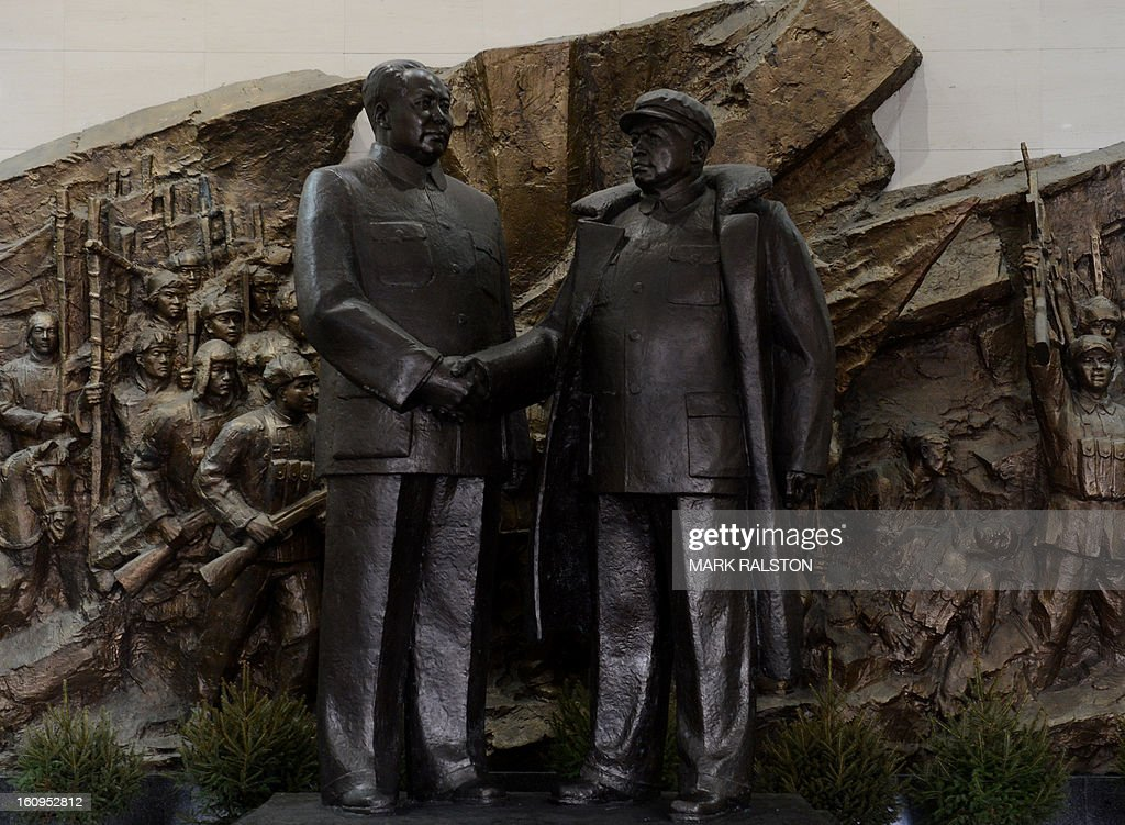 A sculpture showing Chinese leader Mao Zedong (L) and North leader Kim Il-Song at the 'Museum to Commemorate the War to Resist US Aggression' at the Chinese city of Dandong on February 8, 2013. US Secretary of State John Kerry warned that North Korea's expected nuclear tests only increase the risk of conflict and would do nothing to help the country's stricken people. The country has vowed to carry out a third nuclear test soon, and concerns have been raised over the type of fissile material used in the device. AFP PHOTO/Mark RALSTON