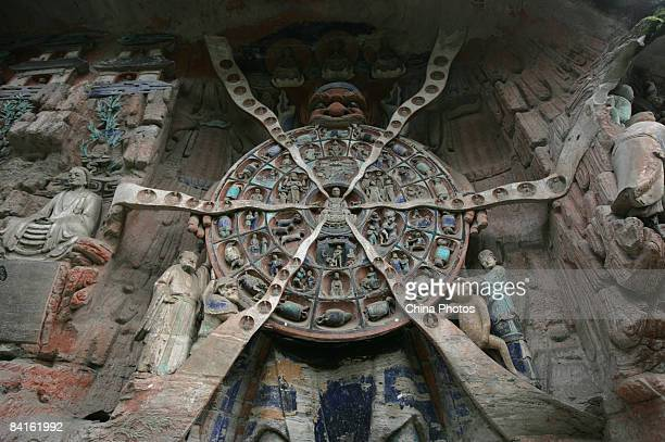 A sculpture showing human's transmigration after death in Buddhism is seen at the Dazu Stone Carving on January 2 2009 in Chongqing China The Dazu...