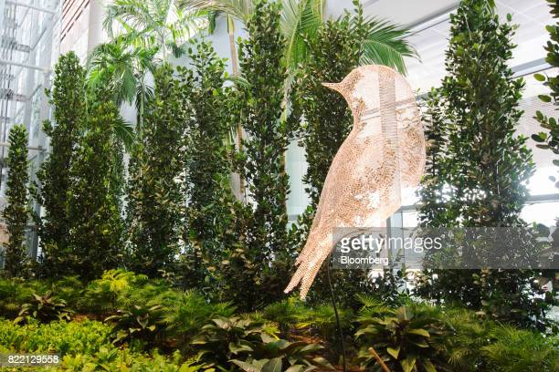 A sculpture titled 'Les Oiseaux ' by Cedric Le Borgne stands beside foliage in the arrival hall area during a media preview of the new Terminal 4 at...