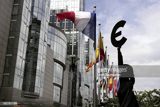 BELGIUM BRUSSELS Sculpture with euro sign flags of Europe in front of the European Parliament in Brussels