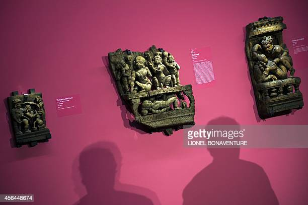 Sculptures are displayed during the exhibition The KamaSutra spirituality and erotism in Indian art at the Paris' pinacotheque on October 1 2014 in...