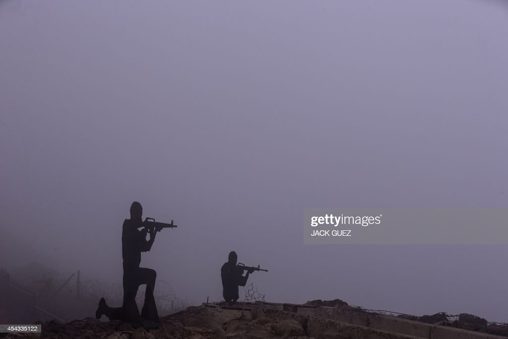 Sculptures of Israeli soldiers standing guard are seen at an army post in Mount Bental in the annexed Golan Heights, on August 29, 2014. Syrian rebels, including Al-Qaeda's affiliate Al-Nusra Front, seized control of the Syrian crossing with the Israeli-occupied Golan Heights, the Britain-based Syrian Observatory for Human Rights said.