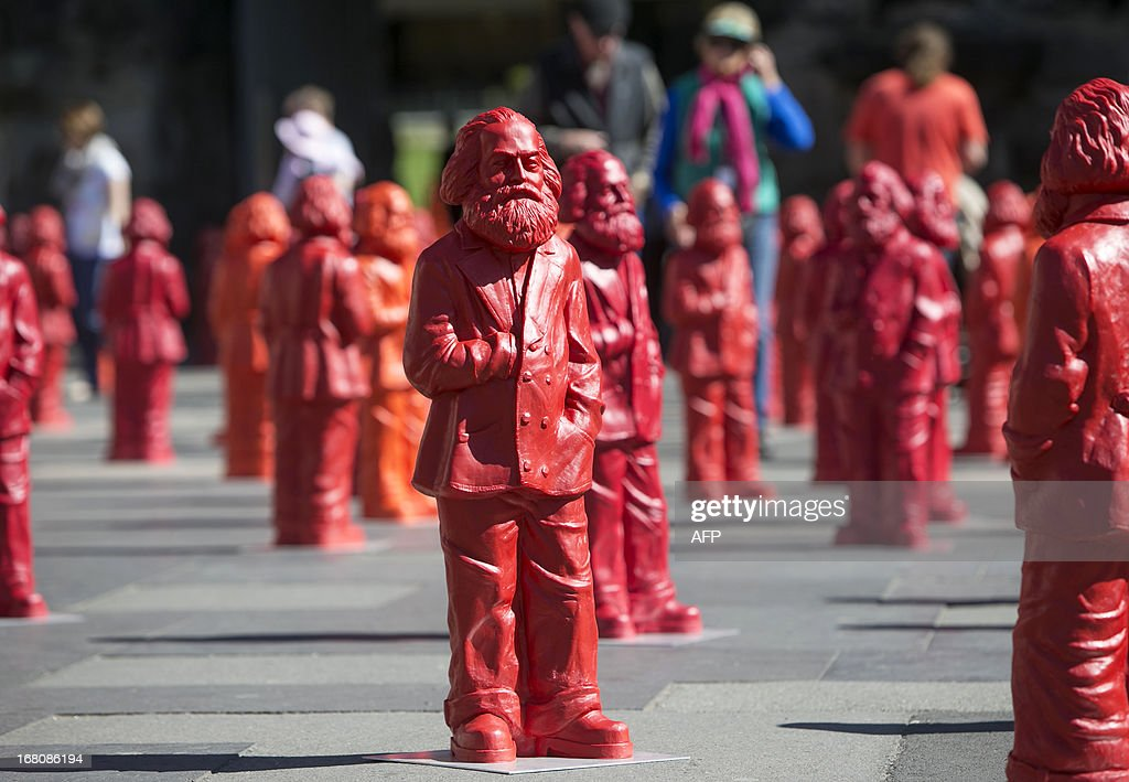 Sculptures of the installation 'Karl Marx' made of 500 figures featuring the communist icon stand in front of the landmark Porta Nigra in Marx'...