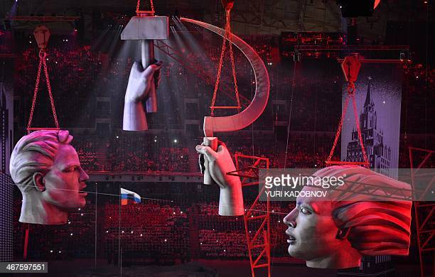 Sculptures portraying a hammer and sickle float above a street scene during the Opening Ceremony of the Sochi Winter Olympics at the Fisht Olympic...