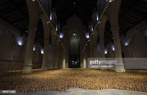 Sculptures that are part of the installation entitled 'Field for the British Isles' by British artist Antony Gormley are laid out in the Nave space...