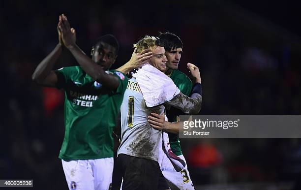 Scunthorpe goalkeeper Sam Slocombe is congratulated by winning penalty taker Miguel Llera during the FA Cup Second Round Replay between Worcester...