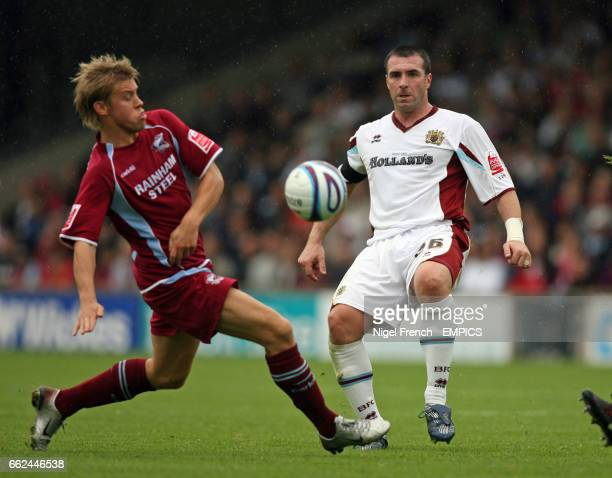 Scunthorpe United's Andy Butler and Burnley's David Unsworth