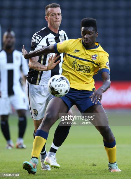 Scunthorpe United's Isaac Assenso and Notts County's Julian Jenner battle for the ball