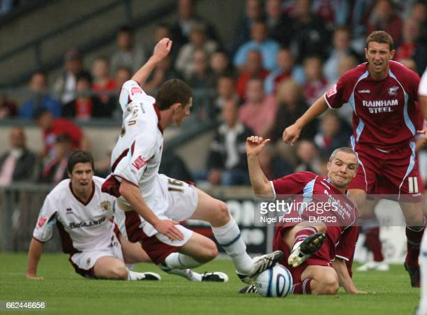 Scunthorpe United's Jim Goodwin and Burnley's Chris McCann