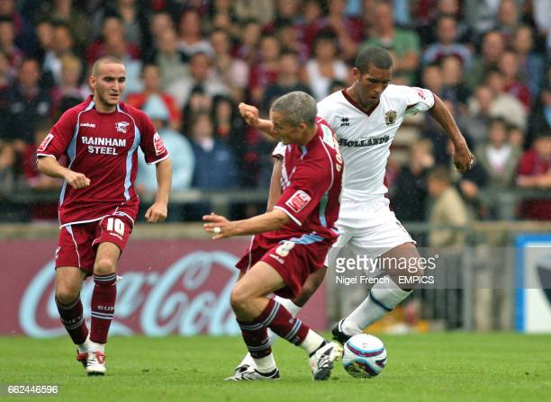 Scunthorpe United's Jim Goodwin is beaten by Burnley's Clarke Carlisle