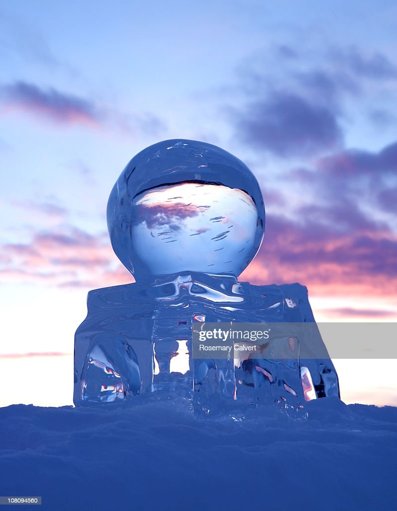Scupture of the globe created in ice at sunset